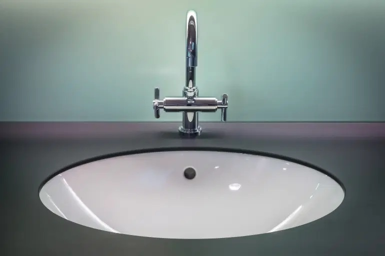 A hole under the bathroom sink faucet